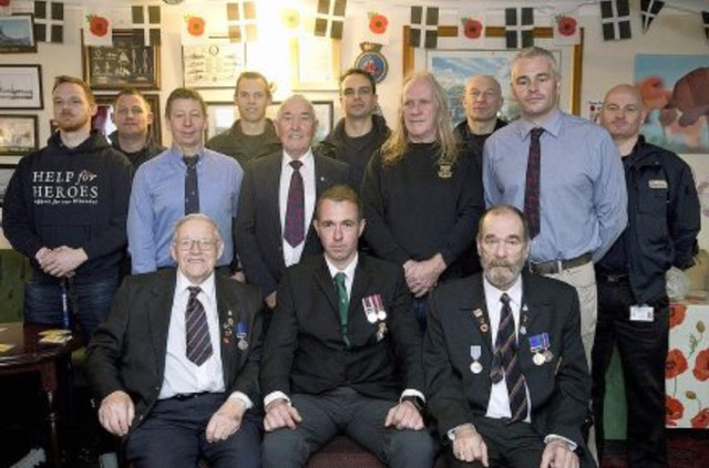 Local firefighters join ex-service personnel at the veterans' breakfast held in the Penzance branch of the Royal British Legion.Picture by Greg Martin